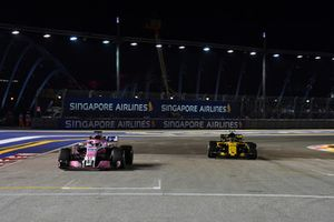 Sergio Perez, Racing Point Force India VJM11 and Carlos Sainz Jr., Renault Sport F1 Team R.S. 18 on the grid