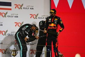 Lewis Hamilton, Mercedes-AMG F1, 1st position, the Mercedes trophy delegate and Alex Albon, Red Bull Racing, 3rd position, celebrate with Champagne on the podium