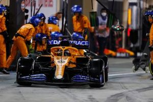Carlos Sainz Jr., McLaren MCL35, leaves his pit box