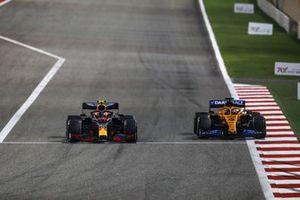 Alex Albon, Red Bull Racing RB16, battles with Carlos Sainz Jr., McLaren MCL35