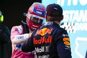 Max Verstappen, Red Bull Racing, congratulates Lance Stroll, Racing Point, on securiing pole