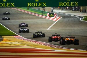 Esteban Ocon, Renault F1 Team R.S.20, Sebastian Vettel, Ferrari SF1000, and Lando Norris, McLaren MCL35