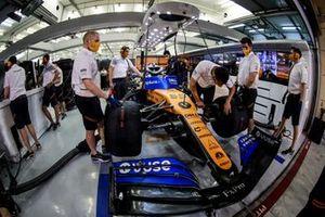 Carlos Sainz Jr., McLaren MCL35 in the garage