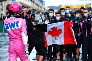Pole man Lance Stroll, Racing Point, celebrates with his team in Parc Ferme