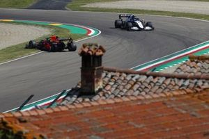Nicholas Latifi, Williams FW43B, approaches Sergio Perez, Red Bull Racing RB16B, who has stopped on track