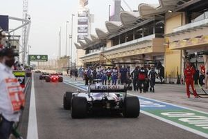Mick Schumacher, Haas VF-21, heads to the grid