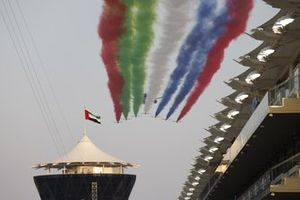 The UAE Air Force Display team Al Fursan escort an Etihad Boeing 787 Dreamliner over the grid