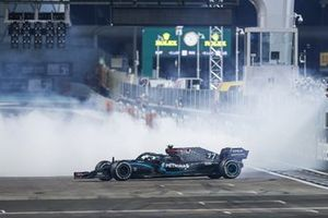 Lewis Hamilton, Mercedes F1 W11, 3rd position, and Valtteri Bottas, Mercedes F1 W11, 2nd position, perform celebratory donuts on the grid after the race