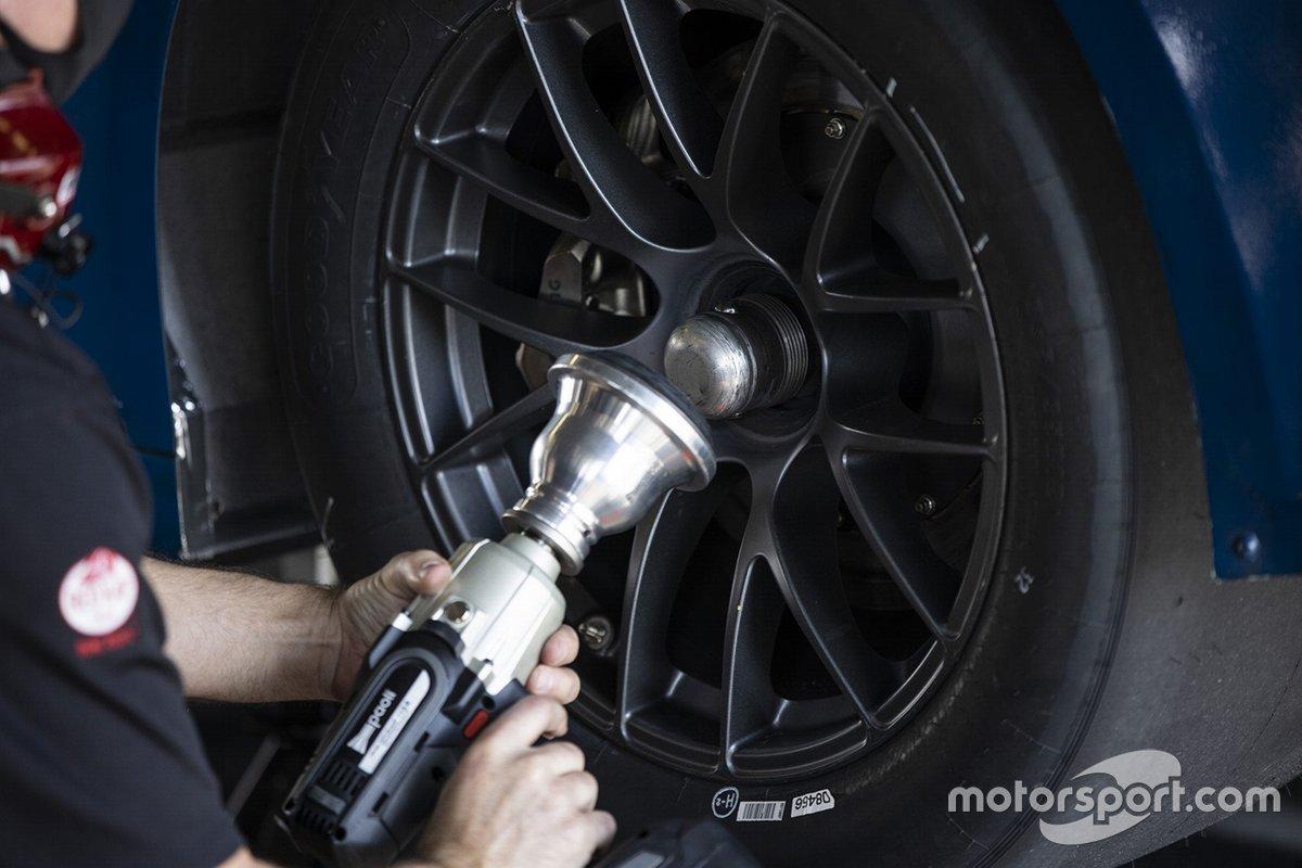 A team member makes adjustments to the NASCAR Next gen car