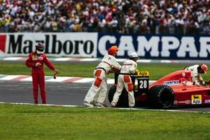 Jean Alesi, Ferrari walks away as marshals attend of his car