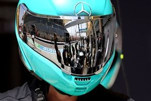 Mercedes pit stop reflected in a pit crew helmet visor