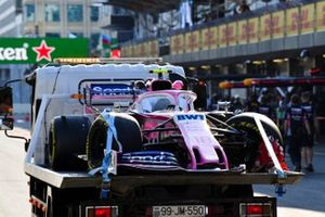 Car of Lance Stroll, Racing Point RP19 retuned to the pit lane on a low loader