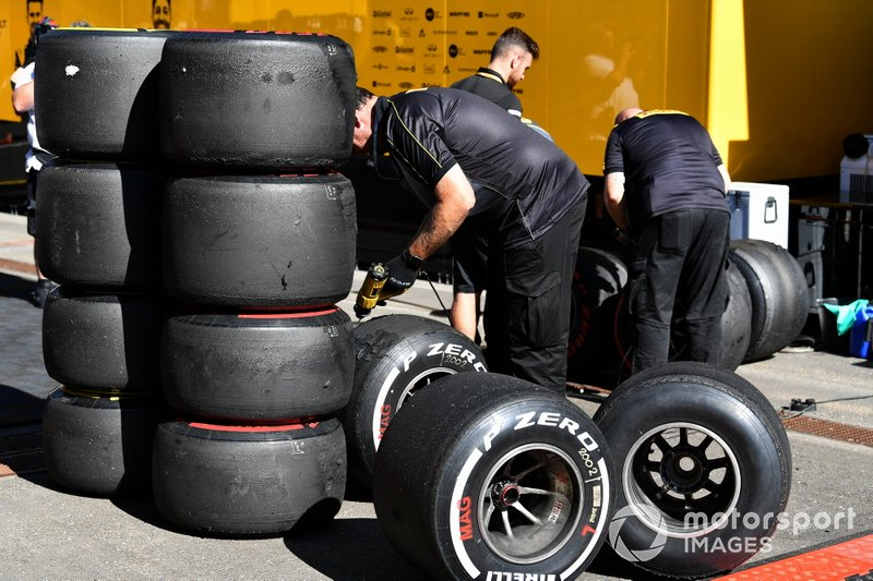 Pirelli technicians work on some tyres