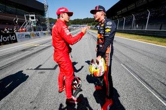 Pole sitter Charles Leclerc, Ferrari, talks with Max Verstappen, Red Bull Racing