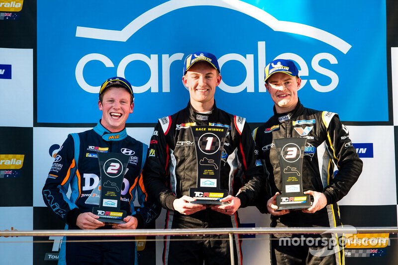 Podium: Race winner Dylan O'Keeffe, Ashley Seward Motorsport, second place Will Brown, HMO Customer Racing, third place James Moffat, Garry Rogers Motorsport