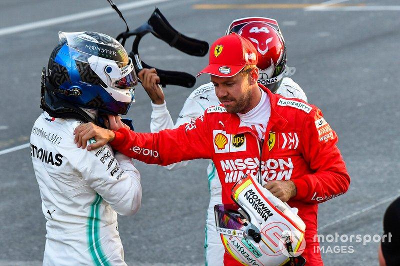 Ganador de la pole Valtteri Bottas y Sebastian Vettel, Ferrari