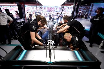 Mechanics at work on the car of Lewis Hamilton, Mercedes AMG F1 W10, in the garage