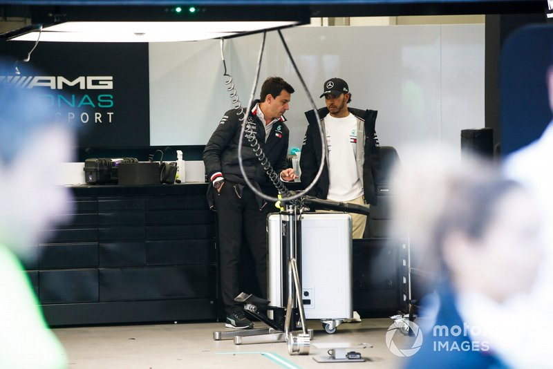 Lewis Hamilton, Mercedes AMG F1, with Toto Wolff, Executive Director (Business), Mercedes AMG, in the garage