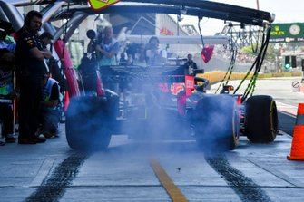 Max Verstappen, Red Bull Racing RB15, lights up his rears in the pits during practice