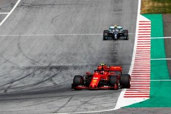 Charles Leclerc, Ferrari SF90, leads Valtteri Bottas, Mercedes AMG W10