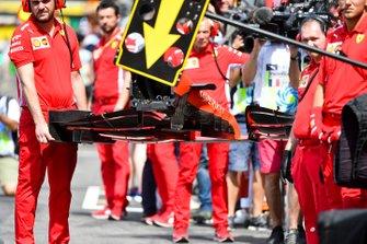 Ferrari mechanics with a front wing