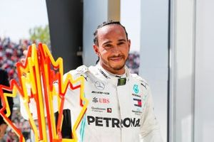 Lewis Hamilton, Mercedes AMG F1 celebrates behind the podium with the trophy