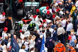 Lewis Hamilton, Mercedes AMG F1 gets out of his car on to a packed grid
