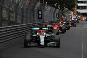 Lewis Hamilton, Mercedes AMG F1 W10, leads Max Verstappen, Red Bull Racing RB15, and the rest of the field at the restart