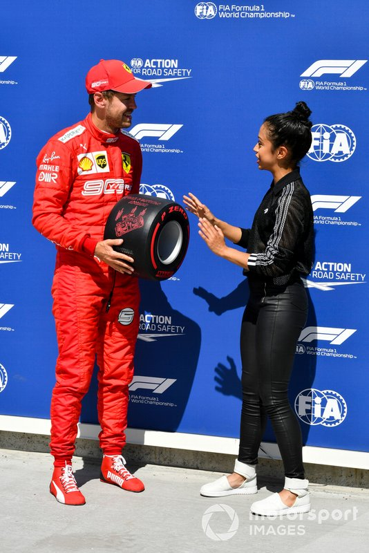 Sebastian Vettel, Ferrari, receives his Pirelli Pole Position Award from actress Liza Koshy