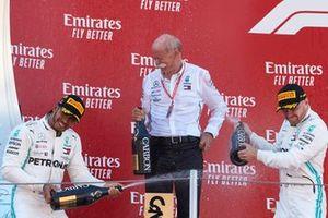 Lewis Hamilton, Mercedes AMG F1, 1st position, Dr Dieter Zetsche, CEO, Mercedes Benz, and Valtteri Bottas, Mercedes AMG F1, 2nd position, spray Champagne on the podium