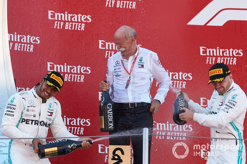 Lewis Hamilton, Mercedes AMG F1, 1st position, Dr Dieter Zetsche, CEO, Mercedes Benz, and Valtteri Bottas, Mercedes AMG F1, 2nd position, spray Champagne on the podium
