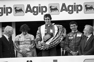 Podio: Nelson Piquet, Brabham, terzo classificato; Alain Prost, McLaren, vincitore; Michele Alboreto, Ferrari, secondo classificato