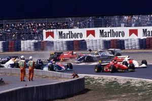 Nicola Larini, Ferrari 412T1 takes off Ayrton Senna, Williams FW16 at the first corner
