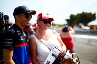 Alexander Albon, Toro Rosso poses for a photograph with a fan