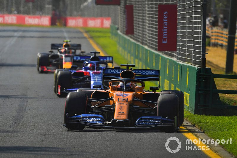 Carlos Sainz Jr., McLaren MCL34, leads Daniil Kvyat, Toro Rosso STR14, and Pierre Gasly, Red Bull Racing RB15