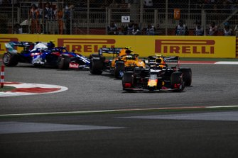 Pierre Gasly, Red Bull Racing RB15, leads Lando Norris, McLaren MCL34, and Alexander Albon, Toro Rosso STR14