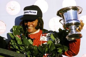 Emerson Fittipaldi, McLaren celebrates his second World Championship title on the podium