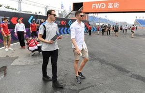 Edoardo Mortara, Venturi Formula E, walks the track with a team member