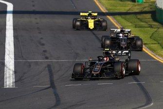 Kevin Magnussen, Haas F1 Team VF-19, leads Romain Grosjean, Haas F1 Team VF-19, and Nico Hulkenberg, Renault F1 Team R.S. 19