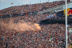 A smoke flare is set off in a grandstand