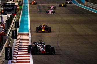 Romain Grosjean, Haas F1 Team VF-18, leads Max Verstappen, Red Bull Racing RB14