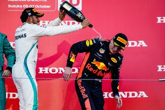 Race winner Lewis Hamilton, Mercedes AMG F1, sprays Champagne over Max Verstappen, Red Bull Racing, on the podium