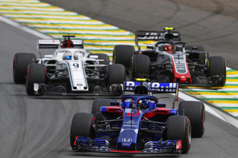 Pierre Gasly, Scuderia Toro Rosso STR13, leads Marcus Ericsson, Sauber C37, and Kevin Magnussen, Haas F1 Team VF-18