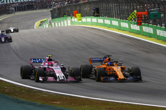 Fernando Alonso, McLaren MCL33, battles with Esteban Ocon, Racing Point Force India VJM11