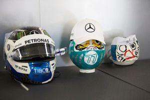 The helmet of Valtteri Bottas, Mercedes AMG F1, alongside some themed art