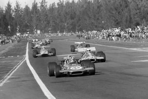 Chris Amon, March 701, leads Jack Brabham, Brabham BT33, and Denny Hulme, Mclaren M14A