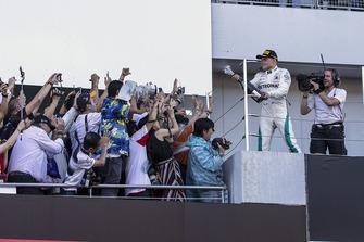 Valtteri Bottas, Mercedes AMG F1 celebrates with the champagne on the podium