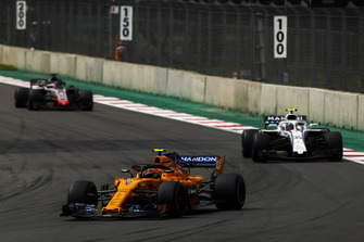 Stoffel Vandoorne, McLaren MCL33, leads Sergey Sirotkin, Williams FW41, and Romain Grosjean, Haas F1 Team VF-18