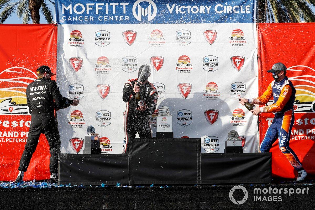 Josef Newgarden, Team Penske Chevrolet, Patricio O'Ward, Arrow McLaren SP Chevrolet , Scott Dixon, Chip Ganassi Racing Honda celebrate on the podium with champagne