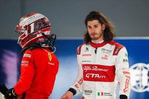 Charles Leclerc, Ferrari, and Antonio Giovinazzi, Alfa Romeo, in Parc Ferme